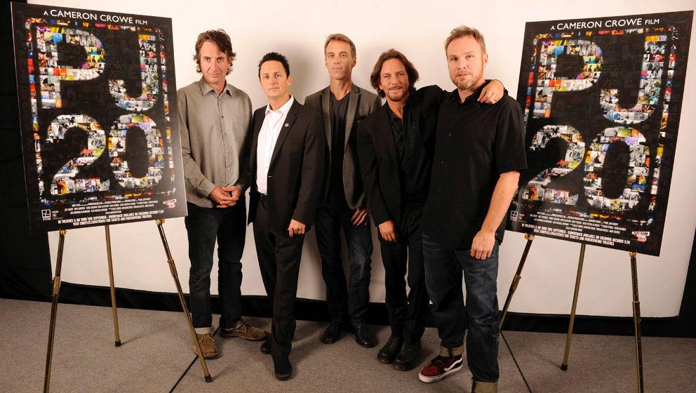 Stone Gossard, Mike McCready, Matt Cameron, Eddie Vedder and Jeff Ament of Pearl Jam pose after the 'Pearl Jam Twenty' press