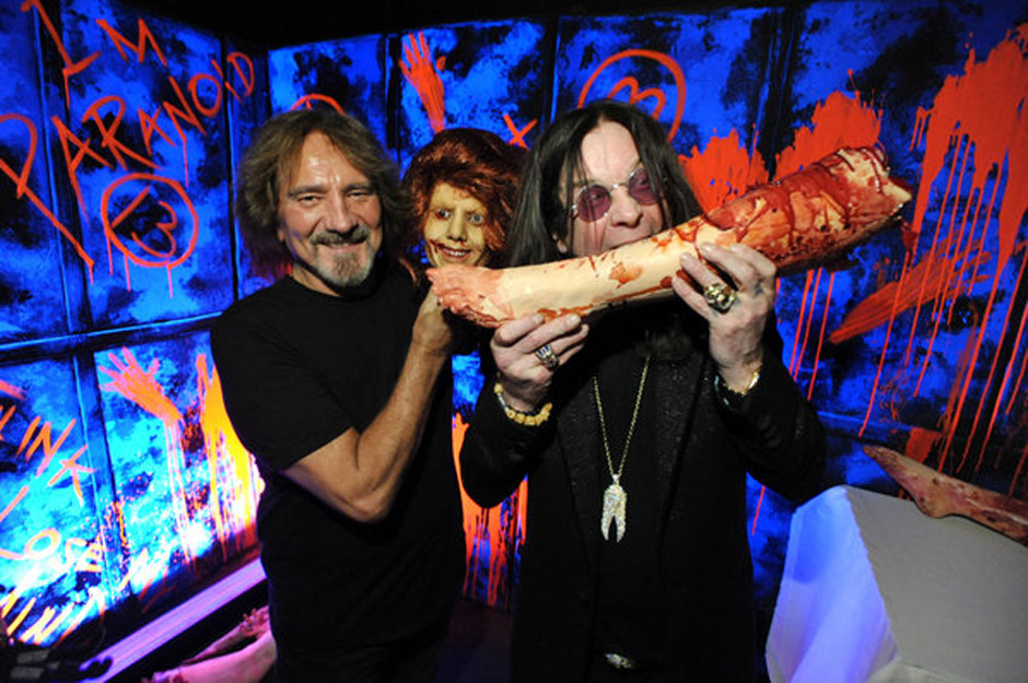 In this Tuesday, Sept. 17, 2013 photo, Geezer Butler, left, and Ozzy Osbourne pose with props at the 'Black Sabbath: 13 3D' m