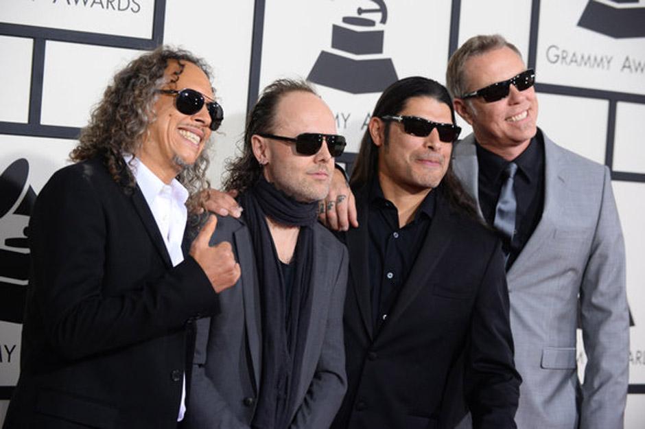 Kirk Hammett, from left, Lars Ulrich, Robert Trujillo and James Hetfield of Metallica arrive at the 56th annual Grammy Awards