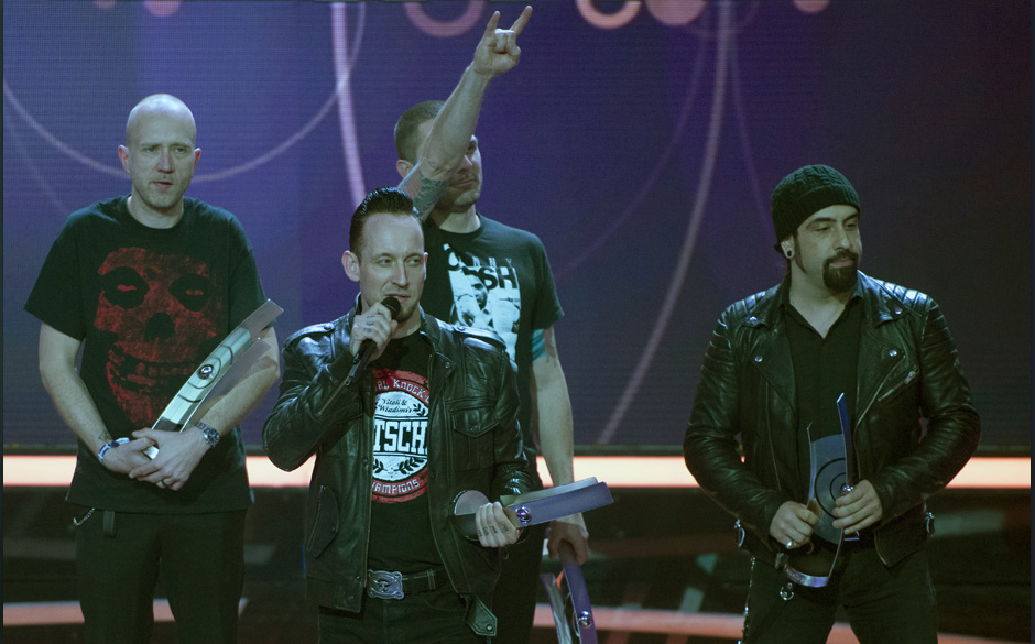 Danish band Volbeat celebrate with their award for Best Rock/Alternative International during the 2014 Echo Music Awards in B