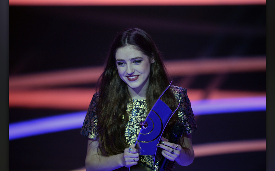 British singer Birdy celebrates with her award for Best Female artist Rock/Pop International during the 2014 Echo Music Award