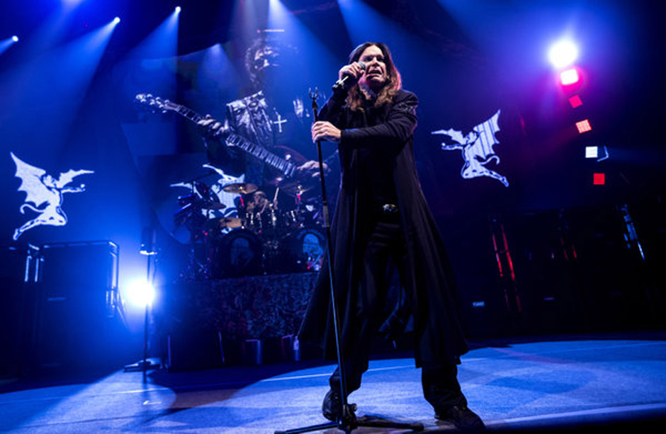 Singer Ozzy Osbourne of British rock band Black Sabbath, performs with guitarist Tony Iommi, seen on screen behind, during a