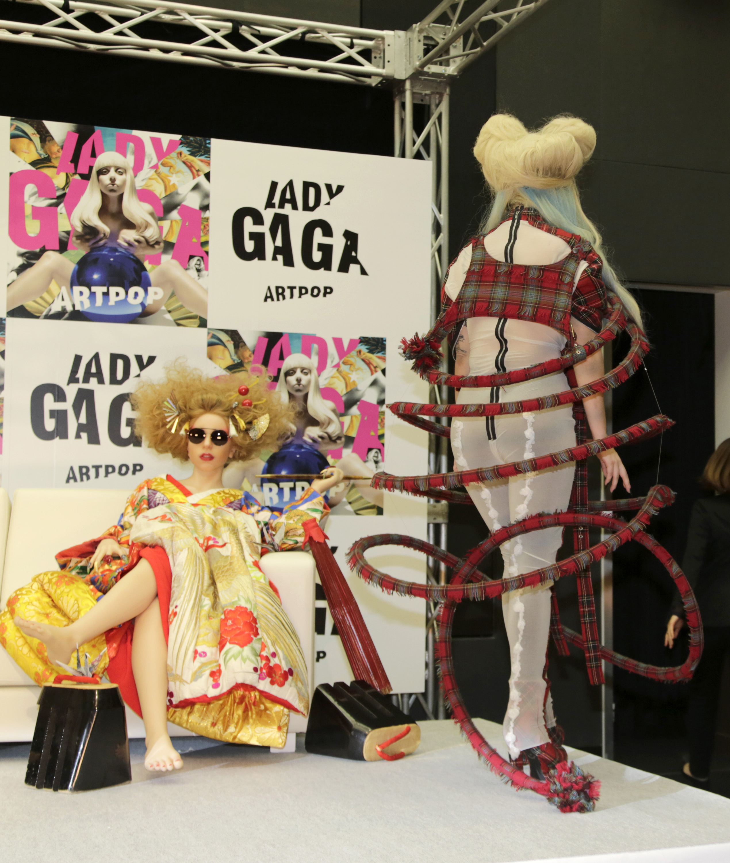 Lady Gaga leaves after a press conference to promote her album 'ARTPOP' in Tokyo, Sunday, Dec. 1, 2013. (AP Photo/Shizuo Kamb
