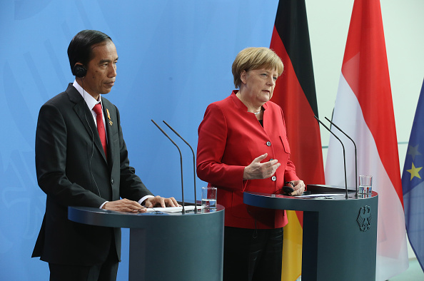 BERLIN, GERMANY - APRIL 18:  German Chancellor Angela Merkel and Indonesian President Joko Widodo speak to the media followin