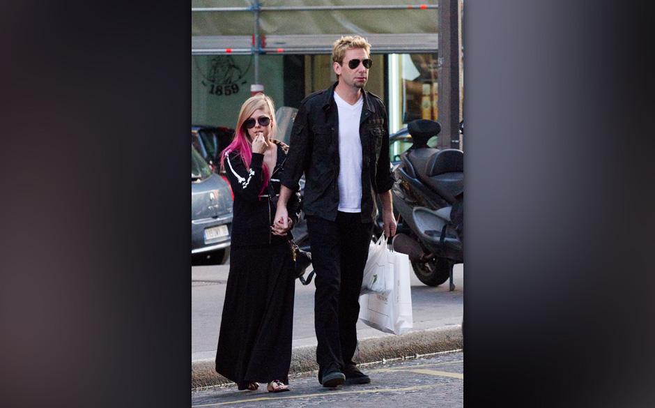 PARIS, FRANCE - SEPTEMBER 13:  Singer Avril Lavigne and Chad Kroeger are seen strolling on September 13, 2012 in Paris, Franc