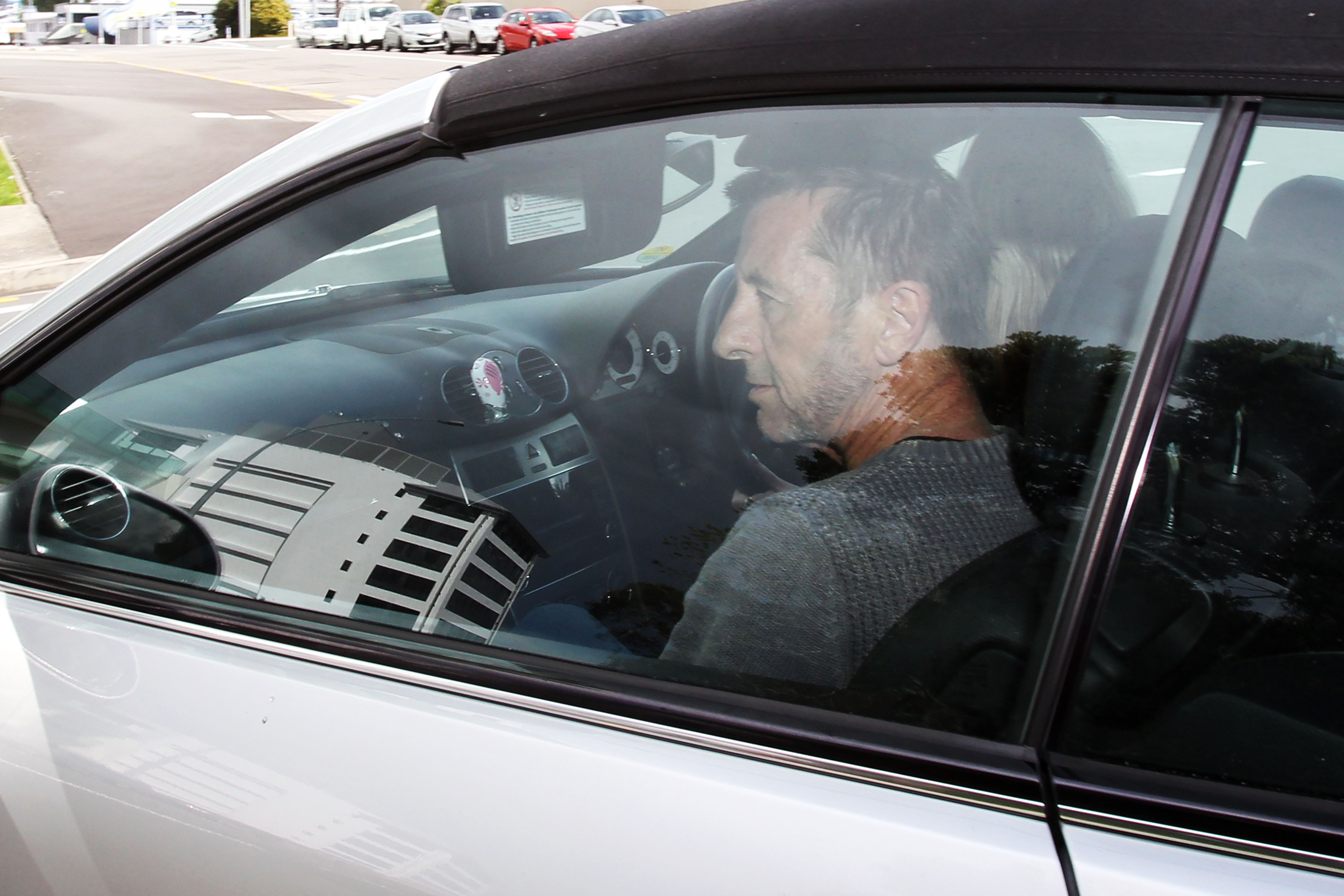 TAURANGA, NEW ZEALAND - NOVEMBER 06:  AC/DC drummer Phil Rudd leaves Tauranga District Court  after being charged with attemp