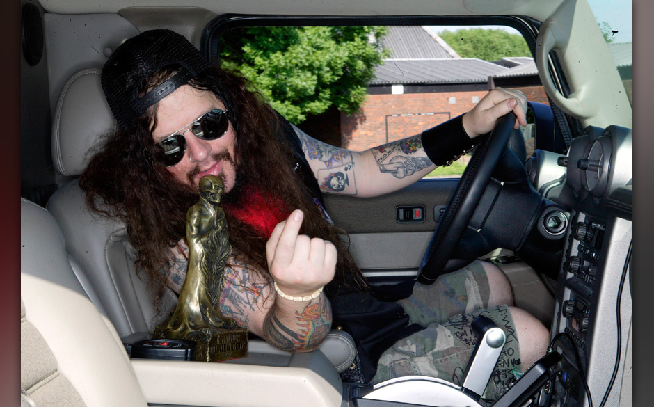 UNITED KINGDOM - JUNE 01:  Photo of Dimebag DARRELL; posed, in car  (Photo by Mick Hutson/Redferns)