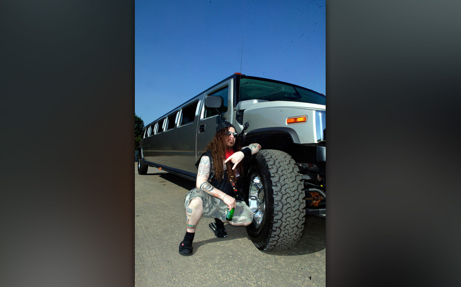 UNITED KINGDOM - JUNE 01:  Photo of Dimebag DARRELL; posed, with stretched Hummer car  (Photo by Mick Hutson/Redferns)