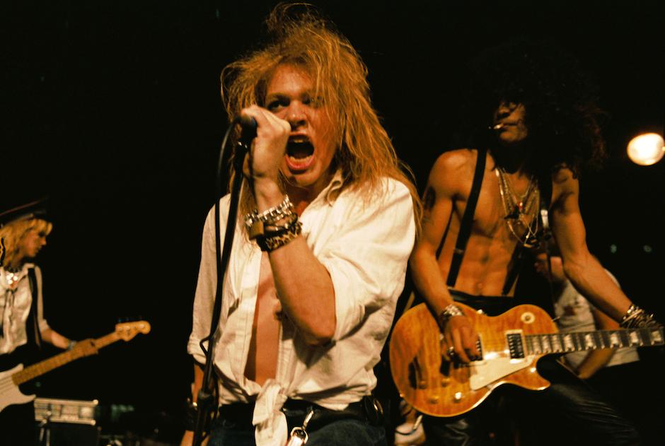 LOS ANGELES - SEPTEMBER 28:  (L-R) Duff McKagan, Axl Rose and Slash of the rock group 'Guns n' Roses' perform at the LA Stree