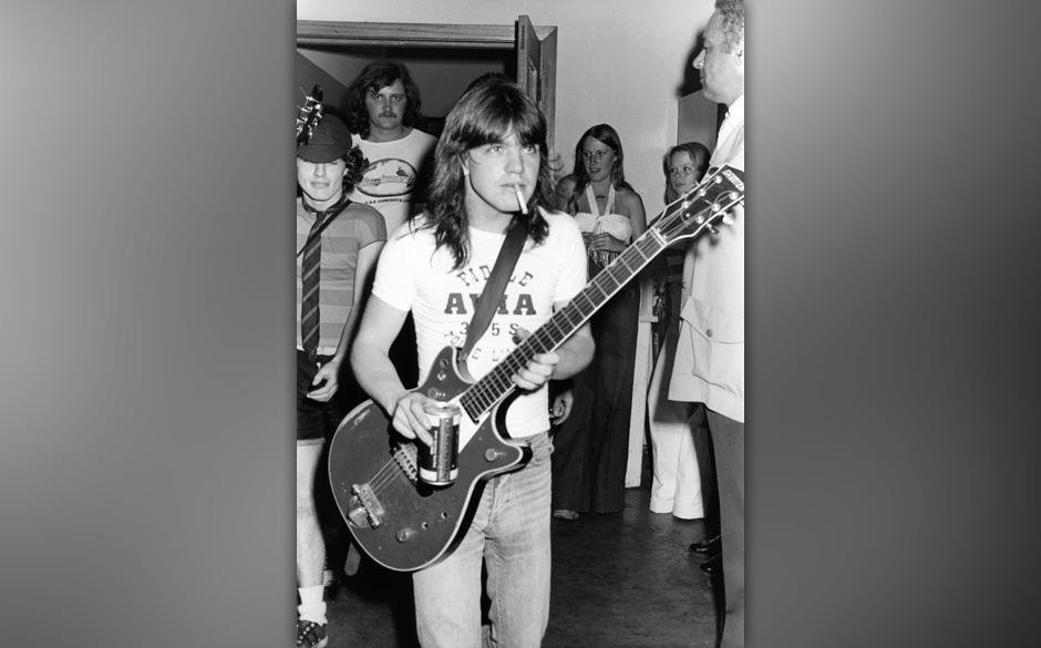 AUSTRALIA - JANUARY 01:  Photo of AC/DC and Malcolm YOUNG and Angus YOUNG; Malcolm Young and Angus Young (behind) backstage