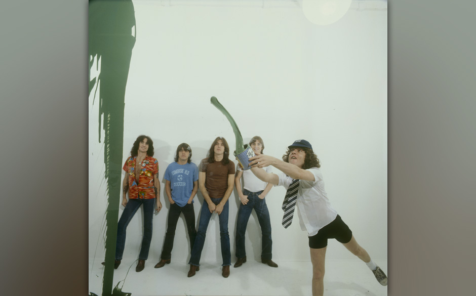 LONDON, UNITED KINGDOM - AUGUST 01: (left to right) Bon Scott, Malcolm Young, Cliff Williams, Phil Rudd and Angus Young of Au