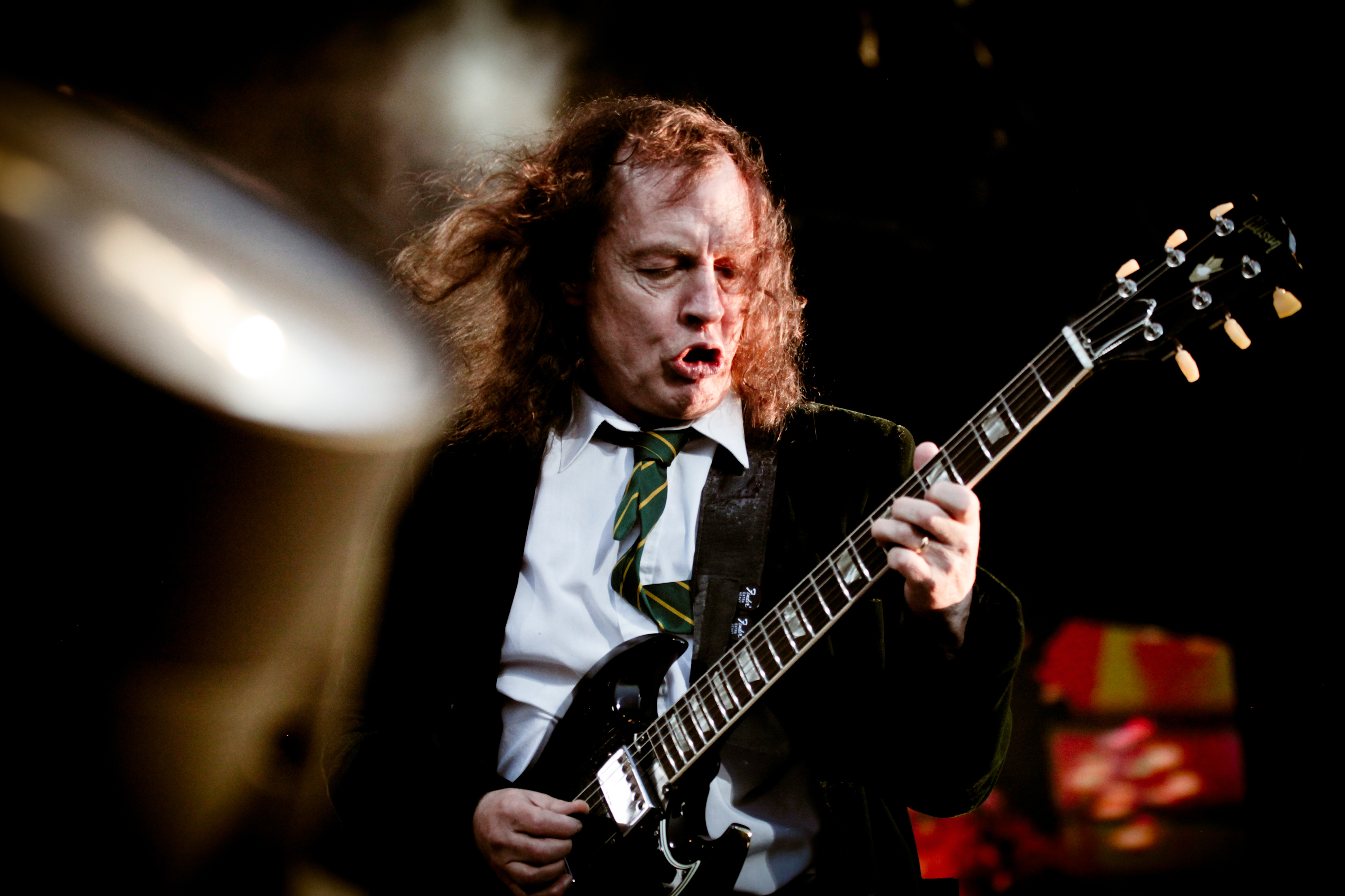 DONINGTON, UK - JUNE 11: Angus Young of AC/DC performs on stage at Download Festival on June 11, 2010 in Donington, UK. (Phot
