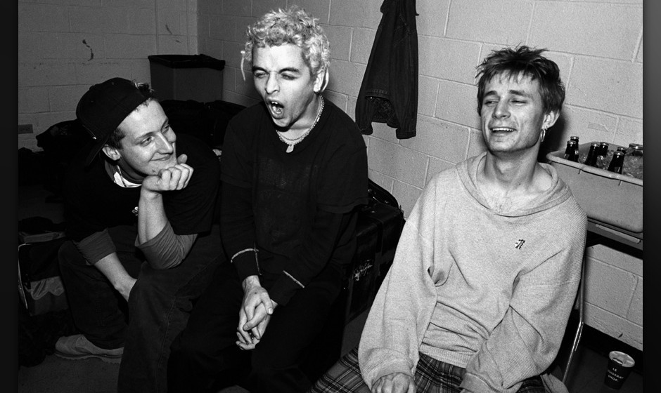 NEW YORK - 1994:  Green Day (L-R: Tre Cool, Billie Joe Armstrong and Mike Dirnt) pose for a portrait backstage at Madison Squ