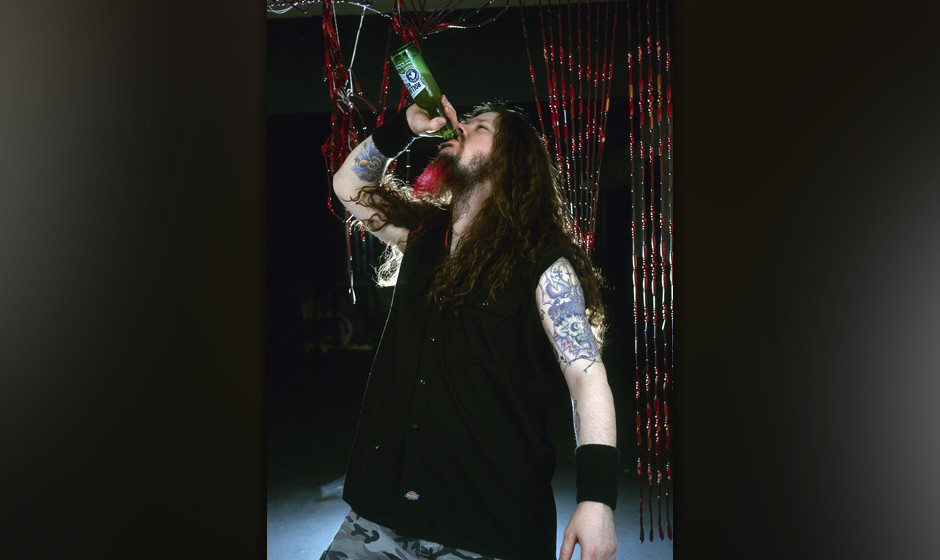 UNITED KINGDOM - OCTOBER 01:  Photo of Dimebag DARRELL and PANTERA; Dimebag Darrell - posed, studio, drinking bottle of beer