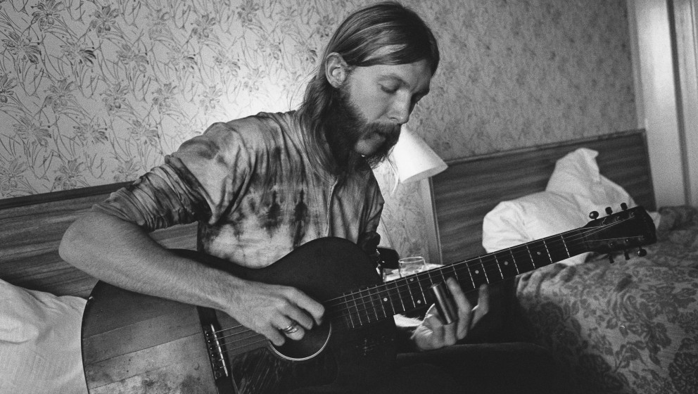 SPARTANBURG, SC - OCTOBER 17: Guitarist Duane Allman uses a steel slide on an acoustic guitar in his hotel room before the Al