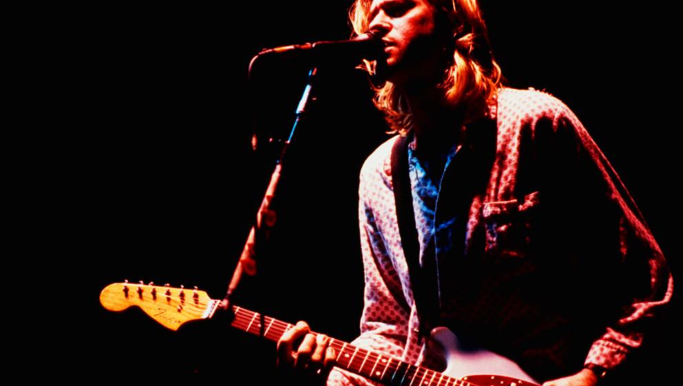 Singer-songwriter and guitarist Kurt Cobain (1967 - 1994) performing with American grunge band Nirvana at the Roseland Ballro