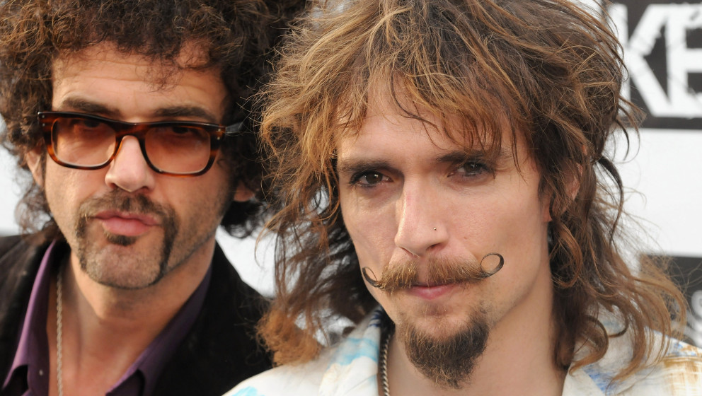 Frankie Poullain and Dan Hawkins from the band The Darkness attend The Relentless Energy Drink Kerrang! Awards at The Brewery