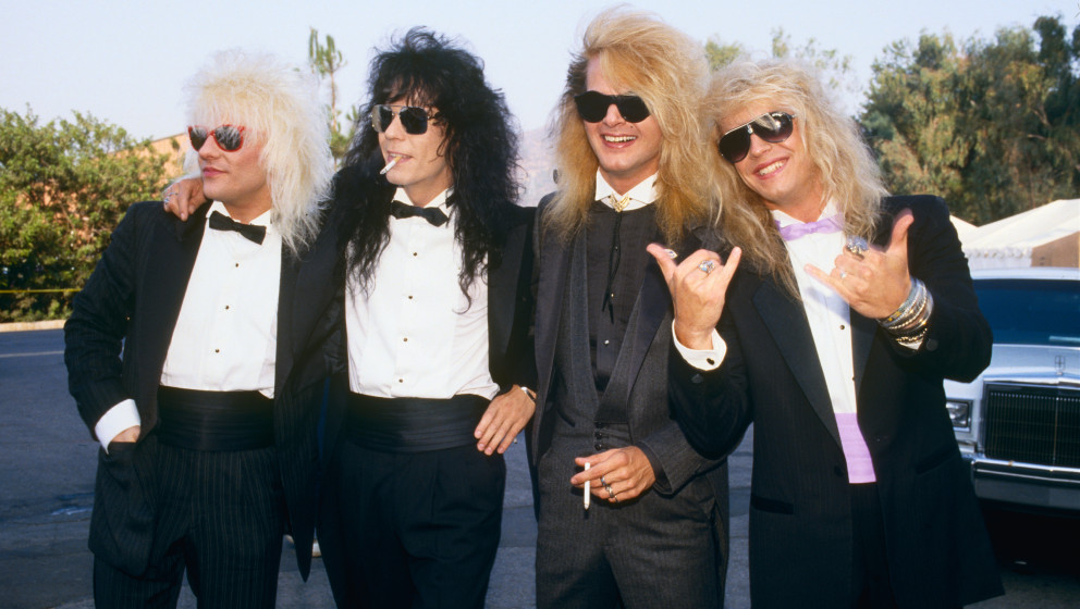UNIVERSAL CITY, CA - 1987:  Members of the rock group Poison, Bret Michaels, C.C. DeVille, Rikki Rockett and Bobby Dall, pose