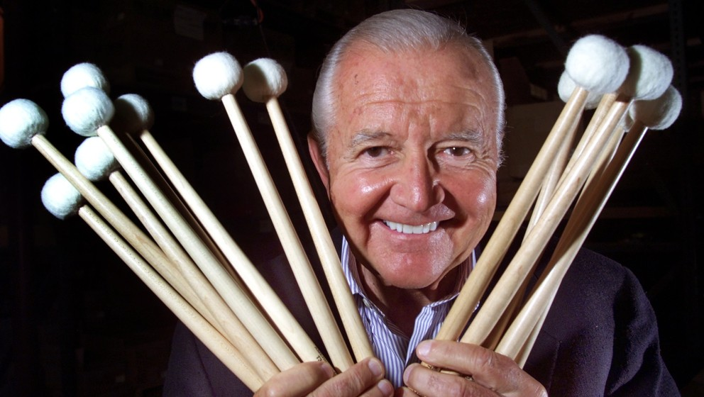 DEDHAM - JUNE 10: Vic Firth, who is retiring from the Boston Symphony Orchestra after 50 years, poses with some of the drumst
