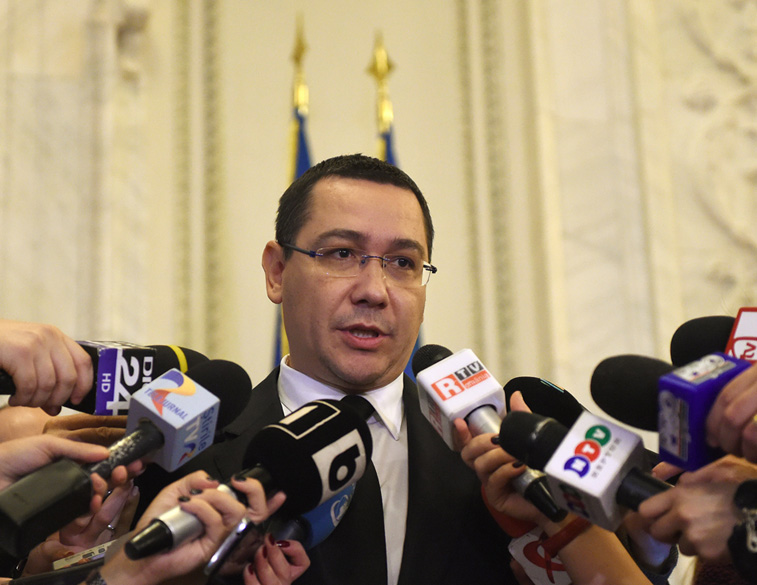 Romania's embattled Prime Minister Victor Ponta addresses journalists as he gets out from the governmental coalition meeting