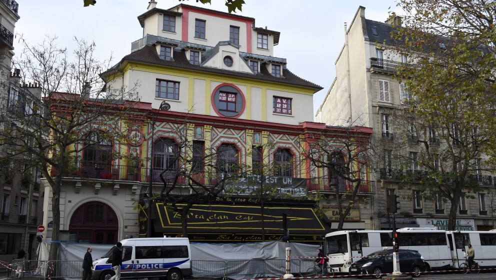 A general view shows the area outside the Bataclan theatre in Paris cordoned off by police on November 18, 2015. Three men we