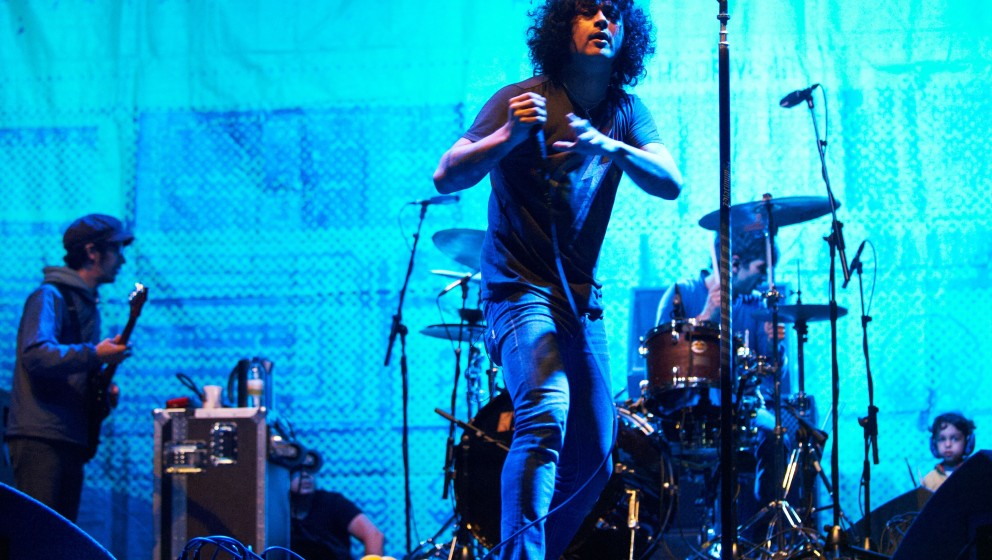 LEEDS, UNITED KINGDOM - AUGUST 26: Omar Rodriguez-Lopez, Cedric Bixler-Zavala and Tony Hajjar of At the Drive-In performs on stage during the final day of Leeds Festival at Bramham Park on August 26, 2012 in Leeds, United Kingdom. (Photo by Gary Wolstenholme/Redferns via Getty Images)