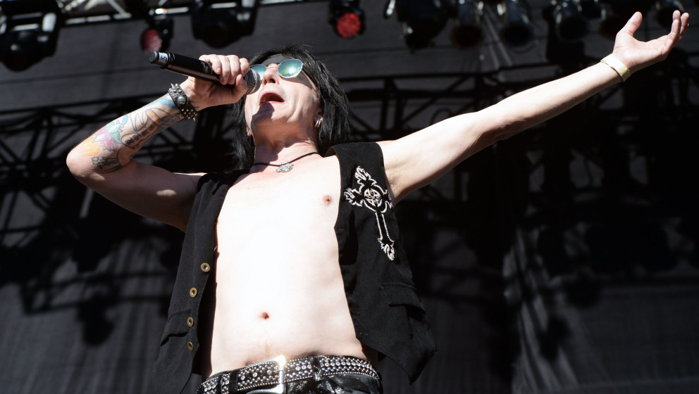 IRVINE, CA - AUGUST 15:  Singer/guitarist Phil Lewis of L.A. Guns performs onstage at the Cathouse Festival at Irvine Meadows