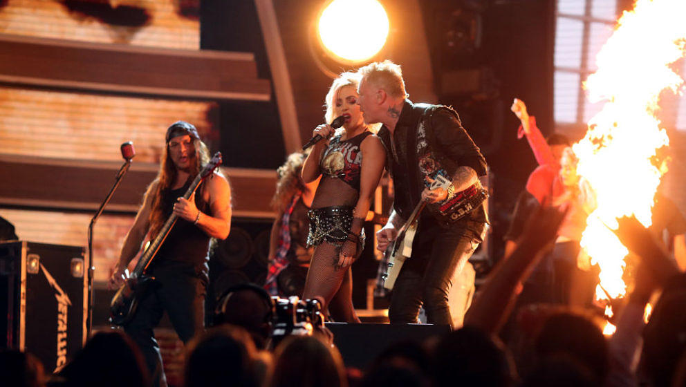 LOS ANGELES, CA - FEBRUARY 12:  (L-R) Musician Robert Trujillo of Metallica, Lady Gaga and James Hetfield of Metaliica during