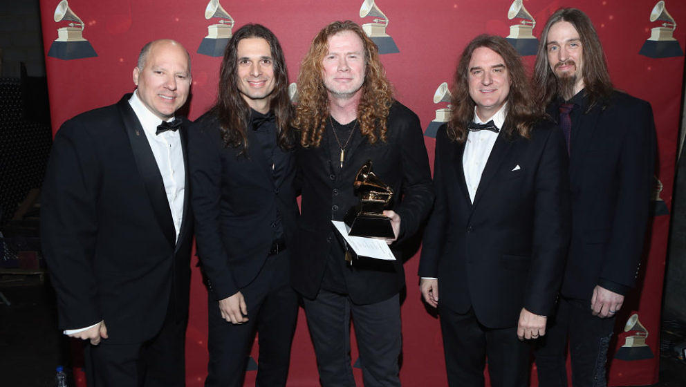 LOS ANGELES, CA - FEBRUARY 12:  (L-R) Chair of the Board for The Recording Academy John Poppo, musicians Kiko Loureiro, Dave
