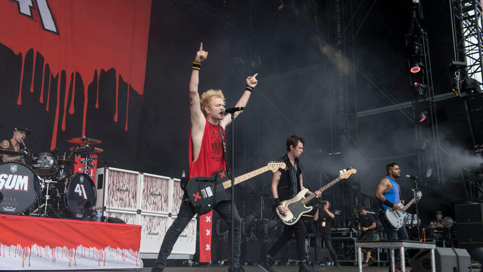 NUERBURG, GERMANY - JUNE 03: (L-R) Frank Zummo, Deryck Whibley, Jason McCaslin and Dave Baksh of SUM 41 perform on stage duri