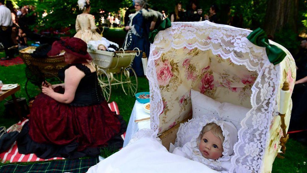Dressed up people attend a so-called 'Victorian Picnic' during the Wave-Gotik-Treffen (WGT) festival in Leipzig, eastern Germ