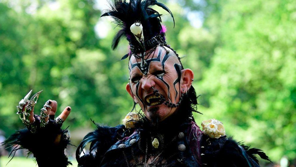 A dressed up man attends a so-called 'Victorian Picnic' during the Wave-Gotik-Treffen (WGT) festival in Leipzig, eastern Germ