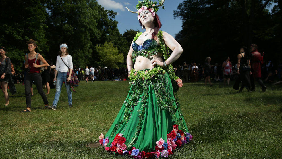 LEIPZIG, GERMANY - JUNE 02:  A young woman who said her creation of her outfit, inspired by nature, just 'grew and grew and g