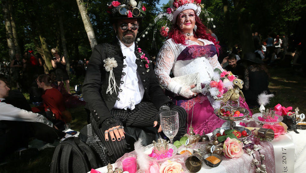 LEIPZIG, GERMANY - JUNE 02:  A couple sit before their banquet as they attend the Victorian Picnic on the first day of the an