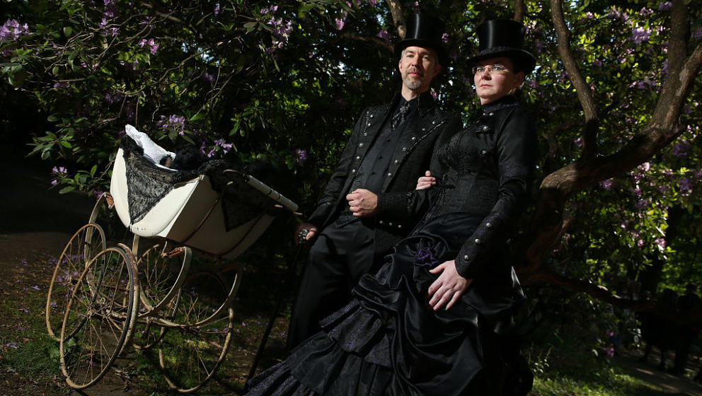 LEIPZIG, GERMANY - JUNE 02:  A couple dressed in Victorian-inspired outfits and wheeling a baby pram attend the Victorian Pic