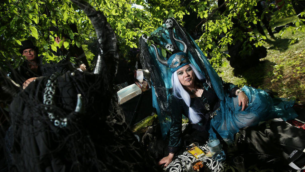 LEIPZIG, GERMANY - JUNE 02:  Visitors with horned headgear relax at their picnic blanket as they attend the Victorian Picnic