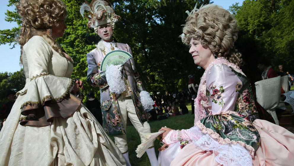 LEIPZIG, GERMANY - JUNE 02:  Visitors in outfits inspired by 17th-century European royal courts attend the Victorian Picnic o
