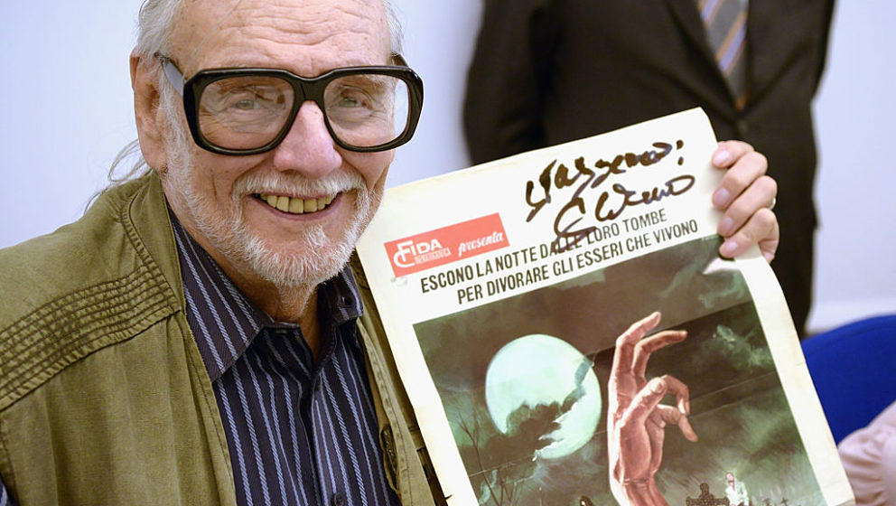 LUCCA, ITALY - APRIL 07:  American film Director, screen writer and editor George Romero signs autographs to his italians fan