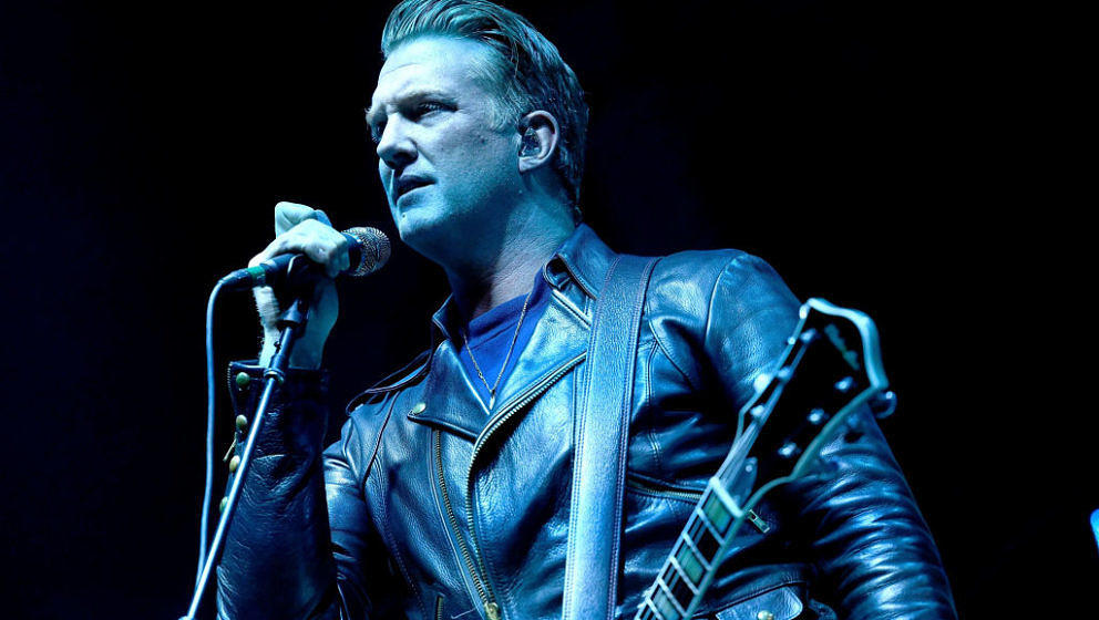 INGLEWOOD, CA - DECEMBER 09:  Singer Josh Homme of the band Queens of the Stone Age performs onstage during KROQ Almost Acous