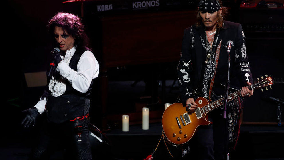 US actor Johnny Depp (R) and singer Alice Cooper perform with The Hollywood Vampires band during the 52th Montreux Jazz Festi