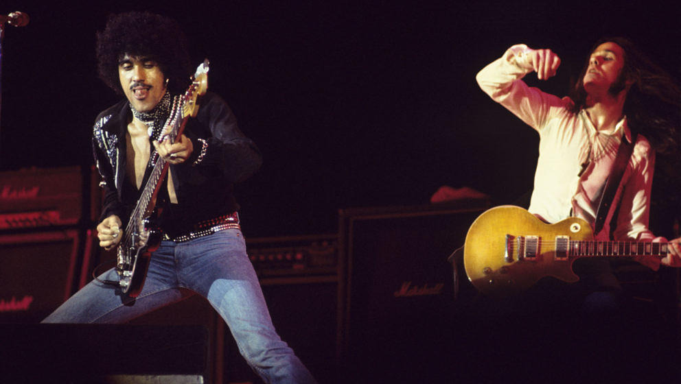 ATLANTA, GA - February 21: Bassist Phil Lynott and guitarist Gary Moore perform with Thin Lizzy at the Omni Coliseum on Febru