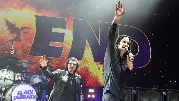 WANTAGH, NY - AUGUST 17:  Tony Iommi (L) and Ozzy Osbourne of Black Sabbath perform onstage on 'The End Tour' at Nikon at Jon
