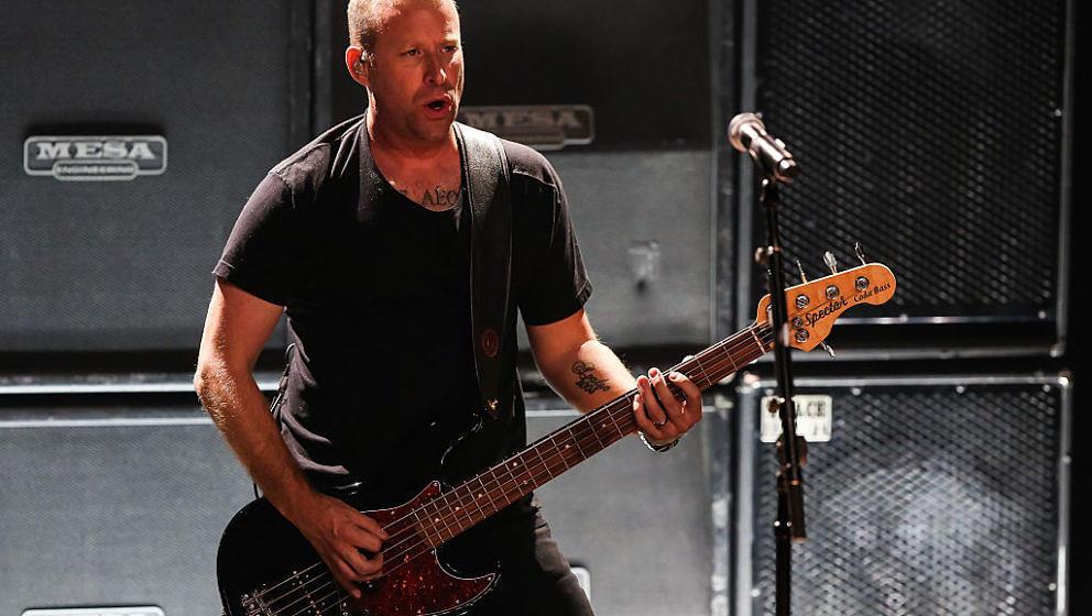BURBANK, CA - NOVEMBER 18:  Musician Mike Kroeger of Nickelback performs at iHeartRadio Theater on November 18, 2014 in Burba