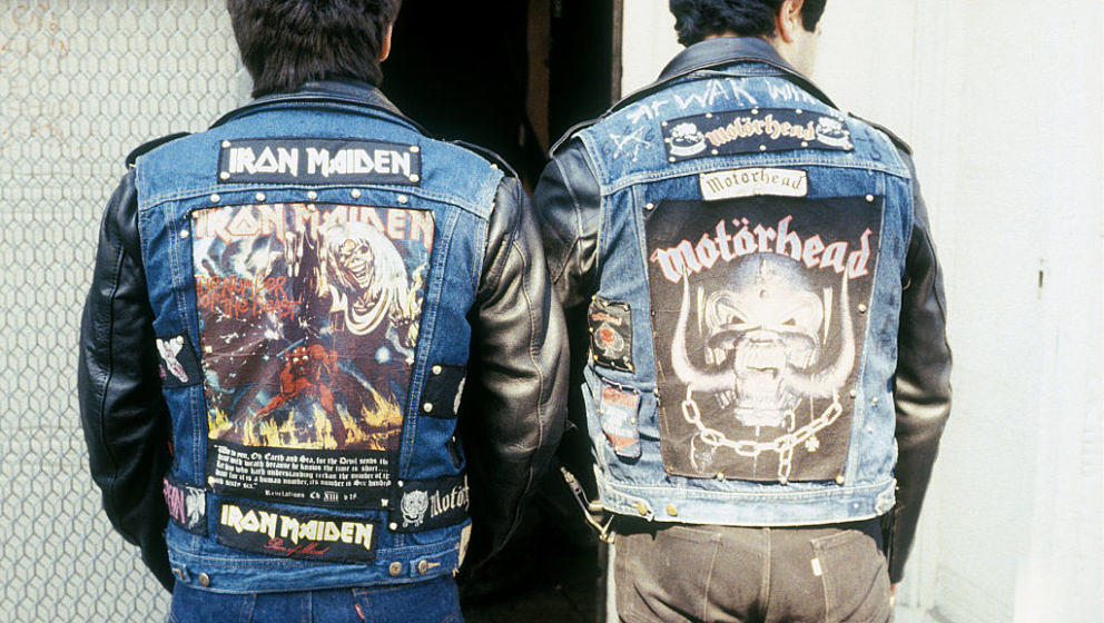 80s Heavy Metal fans wearing Iron Maiden and Motorhead leather jackets, Kings Road, London. 1980's. (Photo by: Paul Hartnett/