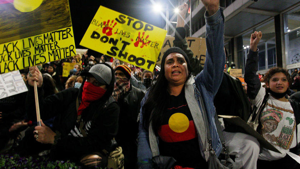 SYDNEY, AUSTRALIA - JUNE 02: Protestors chant and bend down on their knees in Martin Place during a 'Black Lives Matter' rall