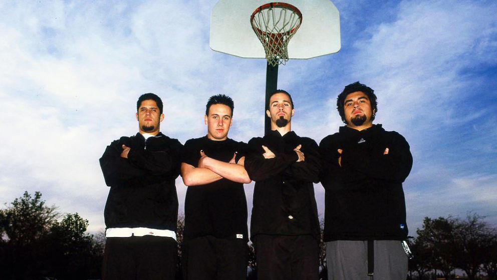 Papa Roach, group portrait on the basketball court of the school they attended, in their home town of Vacaville, California,