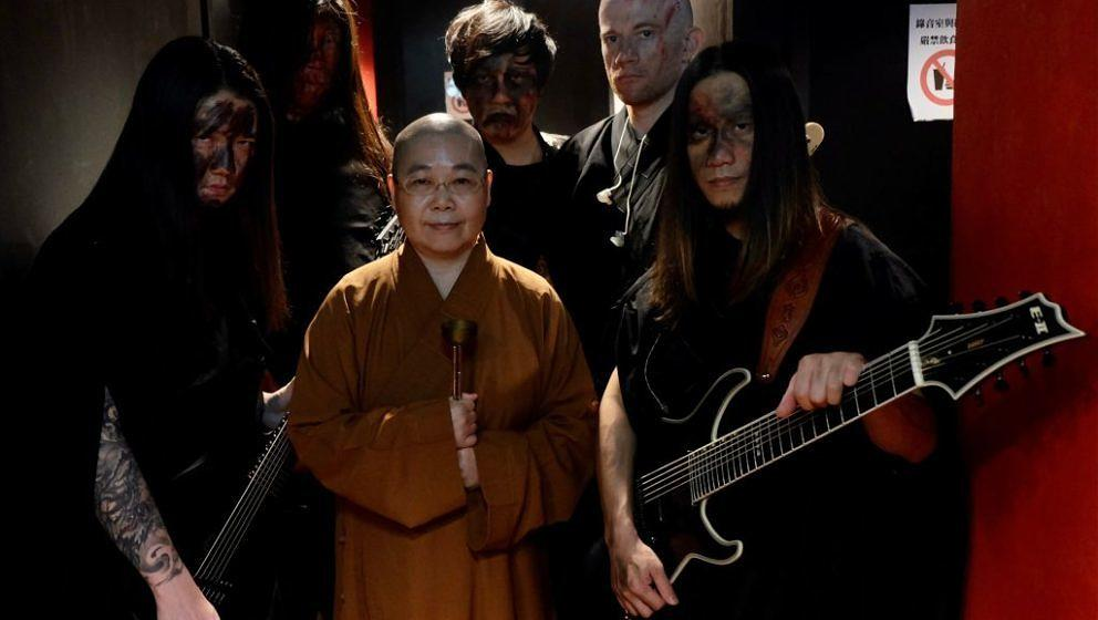 This picture taken on December 3, 2020 shows members of Taiwanese death metal band 'Dharma' posing for photographs during a r